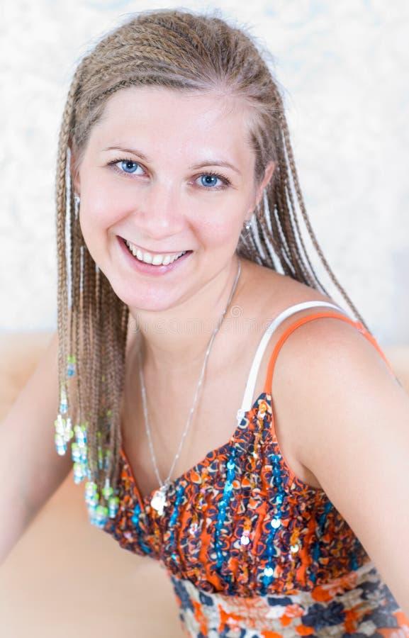 Ritratto della ragazza con le trecce immagine stock