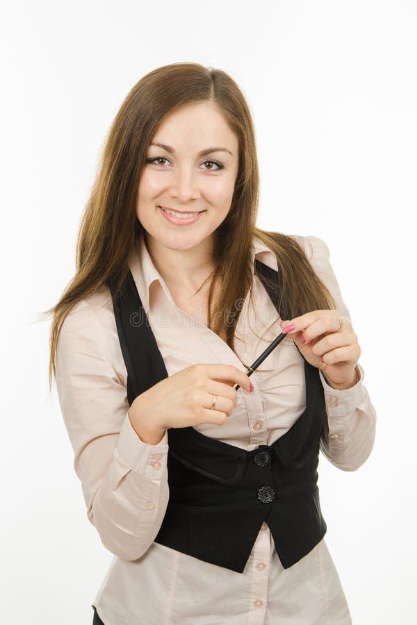 Ritratto della ragazza di affari con la penna a disposizione fotografie stock