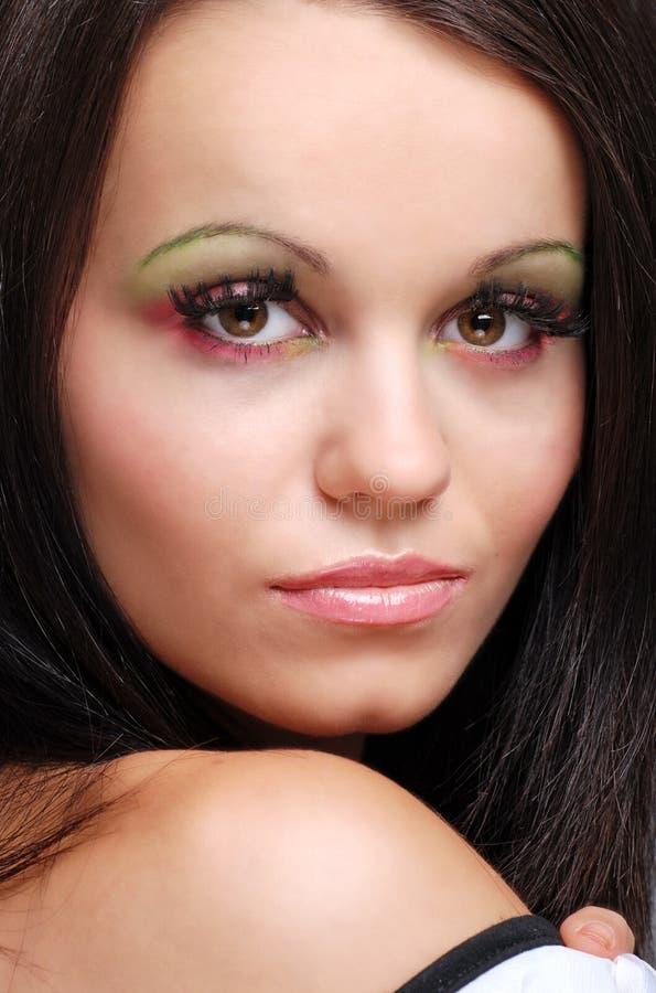 Ritratto delle spalle e capo di giovane woma del brunette immagini stock libere da diritti