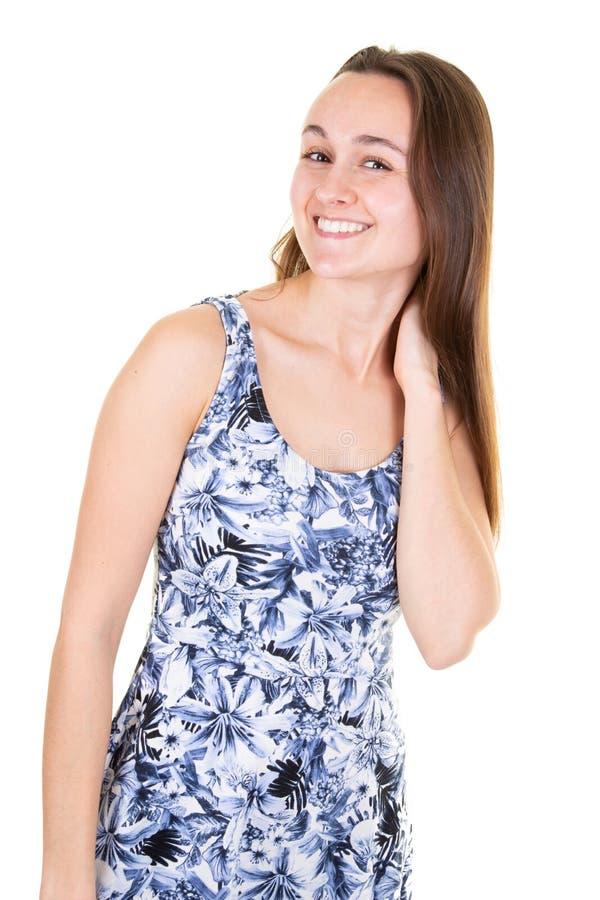 Ritratto di bella donna caucasica emotiva in vestito blu che ride mentre sembrando condizione laterale contro il fondo bianco fotografia stock libera da diritti