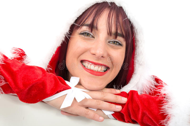 Ritratto di bella ragazza che indossa i vestiti del Babbo Natale fotografia stock