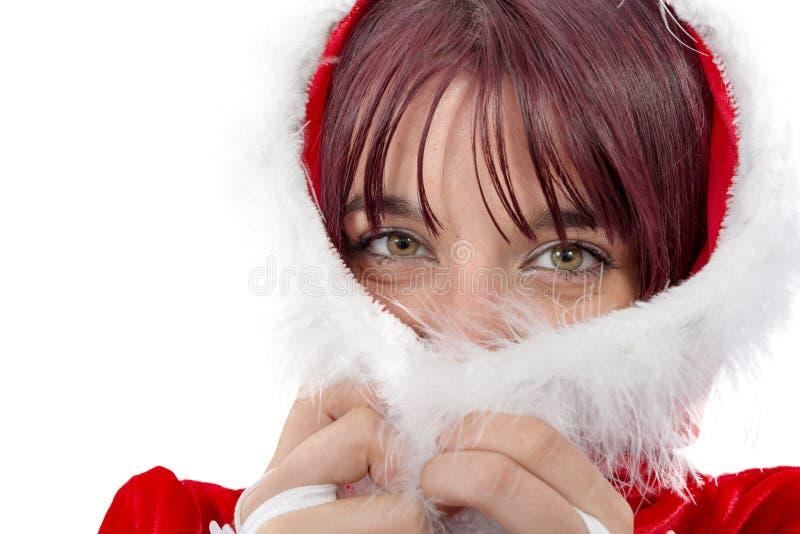 Ritratto di bella ragazza che indossa i vestiti del Babbo Natale fotografia stock libera da diritti