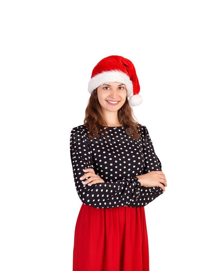 Ritratto di bella ragazza sexy sorridente in vestito ragazza emozionale in cappello di natale del Babbo Natale isolato su fondo b immagini stock libere da diritti