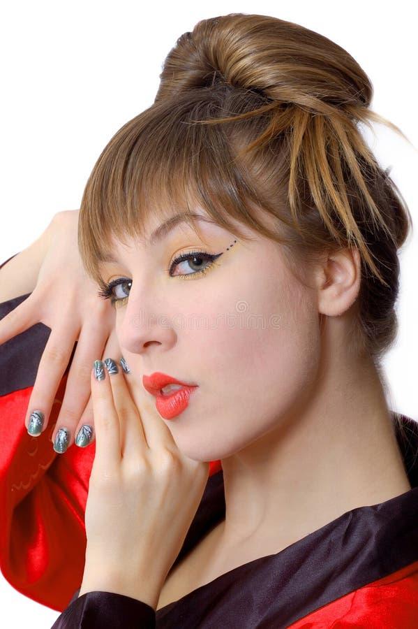 Ritratto di bella ragazza smiiling in kimono fotografia stock