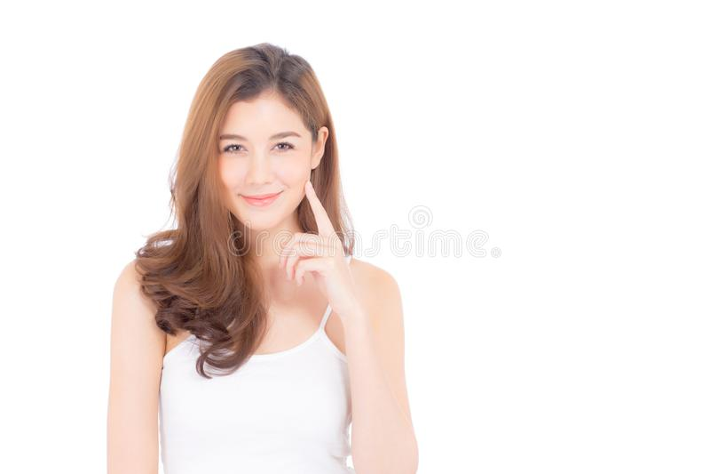 Ritratto di bello trucco asiatico della donna del cosmetico - guancia e sorriso di tocco della mano della ragazza sul fronte attr immagini stock