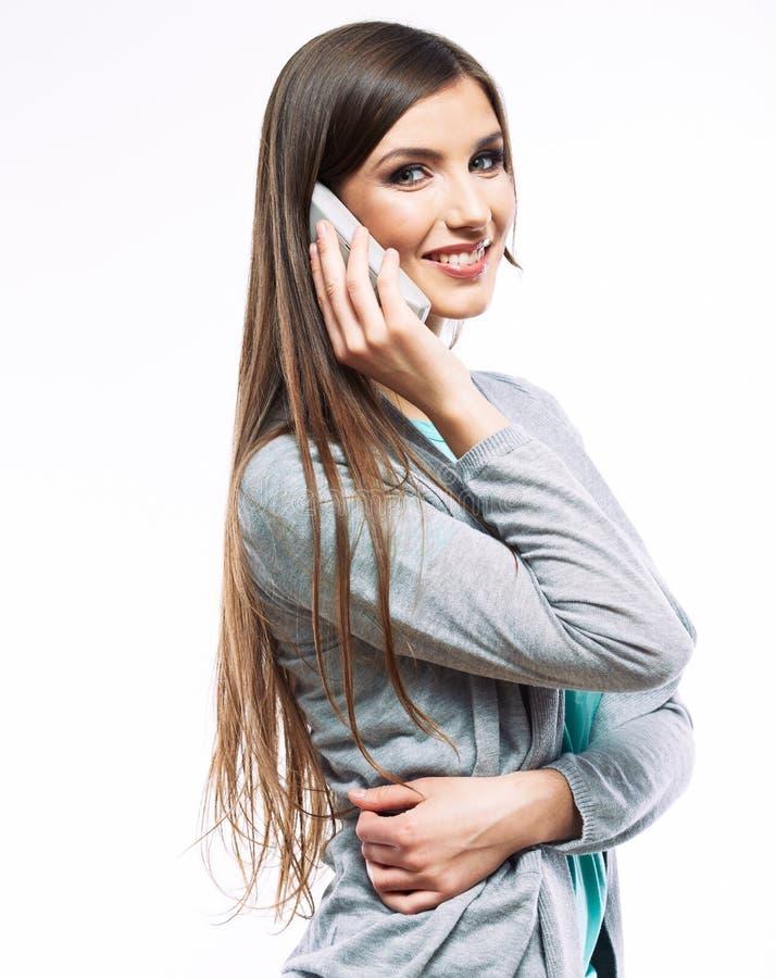 Ritratto di conversazione del telefono della donna Priorità bassa bianca immagine stock