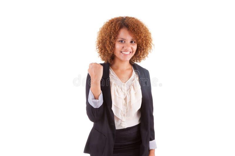 Ritratto di giovane donna afroamericana di affari con clenche fotografia stock