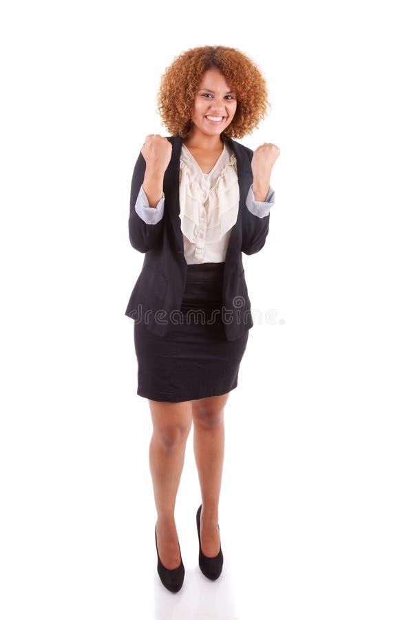 Ritratto di giovane donna afroamericana di affari con clenche immagini stock