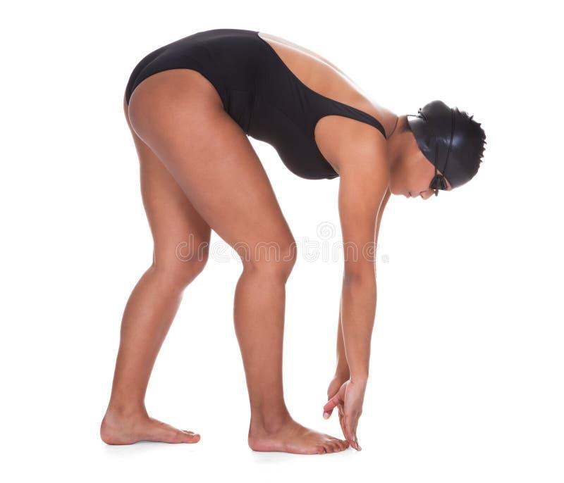 Ritratto di giovane nuotatore femminile fotografia stock