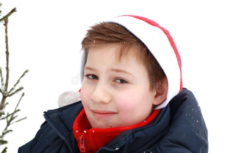 Ritratto di giovane ragazzo in un cappello di Santa fotografie stock