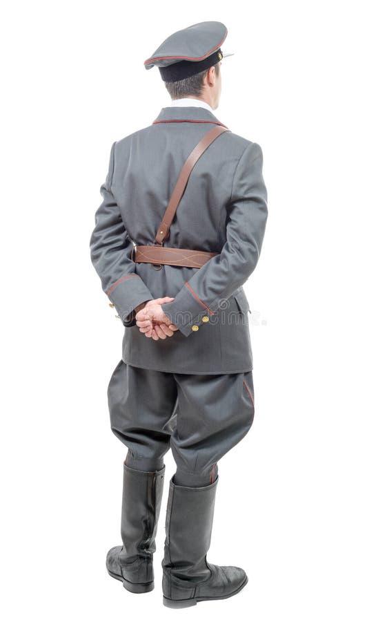 Ritratto di giovane ufficiale dell'esercito sovietico, isolato su briciolo fotografie stock