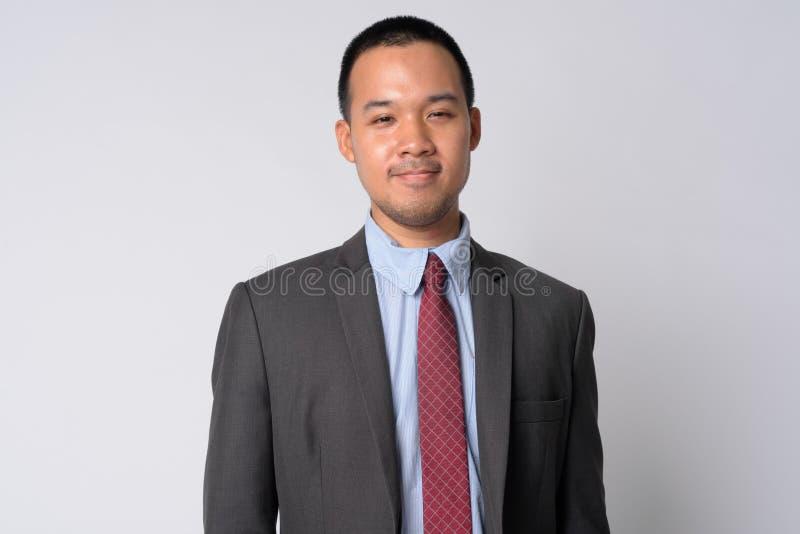 Ritratto di giovane uomo d'affari asiatico in vestito fotografia stock