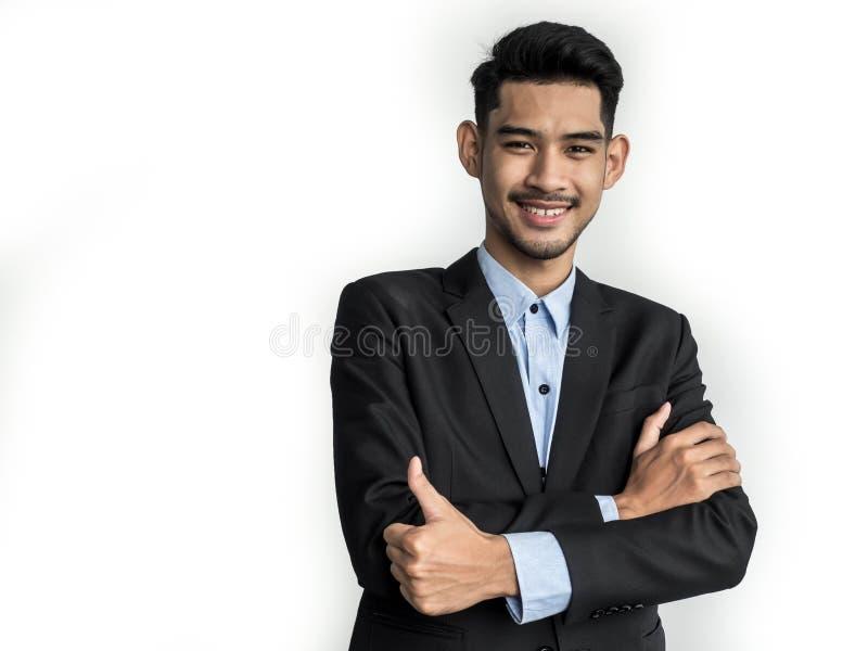 Ritratto di giovane uomo d'affari sorridente felice, isolato su fondo bianco immagini stock