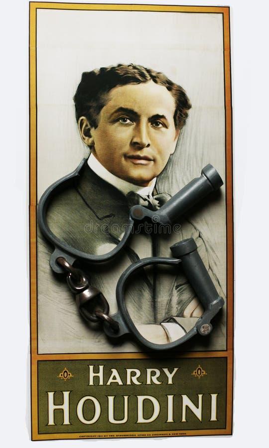 Ritratto di Harry Houdini sul manifesto con le manette fotografia stock