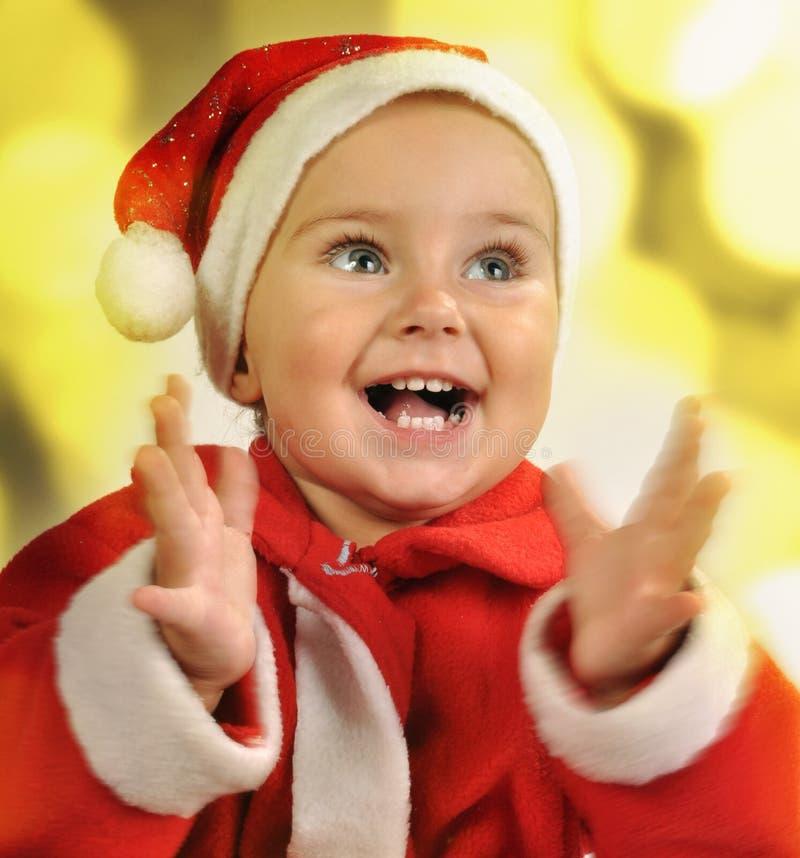 Ritratto di Natale delle mani d'applauso di un bambino immagine stock libera da diritti