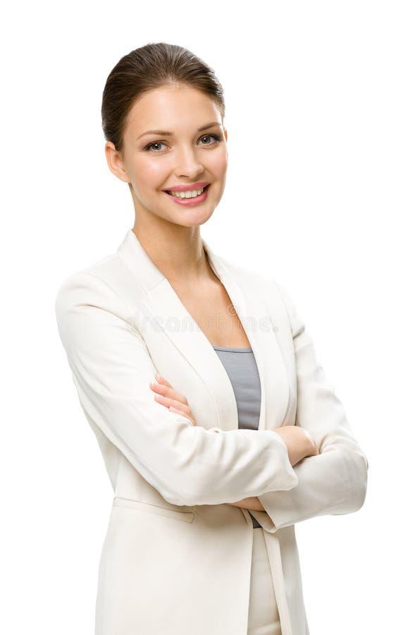 Ritratto di ritratto a mezzo busto dell'uomo femminile di affari con le mani attraversate fotografie stock libere da diritti