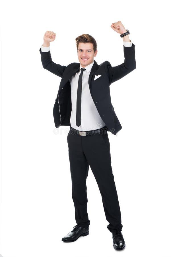 Ritratto di riuscito uomo d'affari con le armi alzate fotografie stock libere da diritti