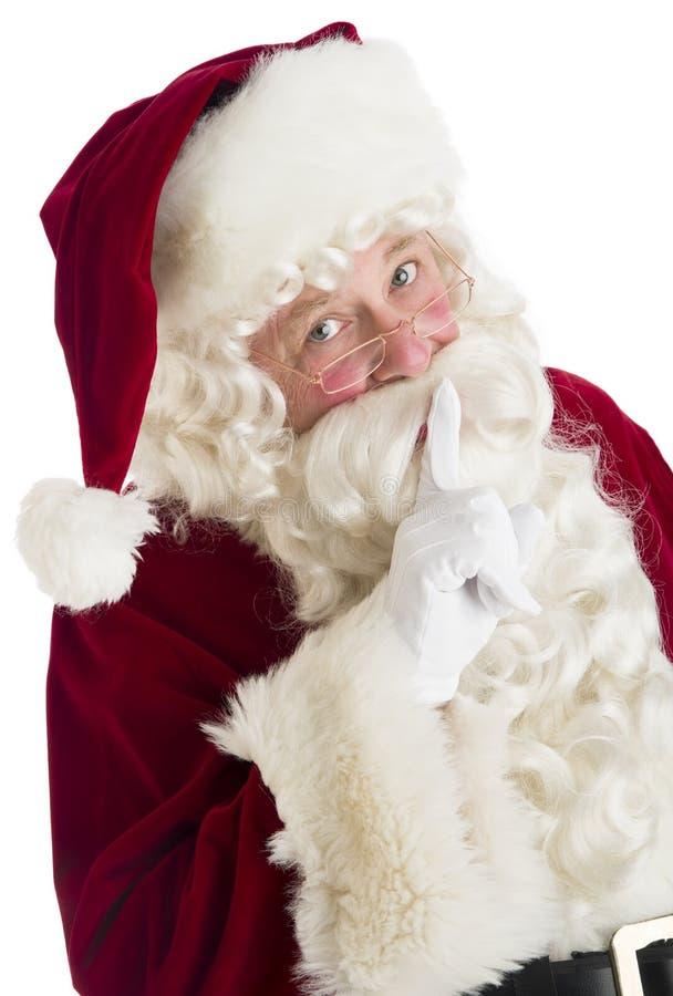 Ritratto di Santa Claus Making Silence Gesture fotografia stock