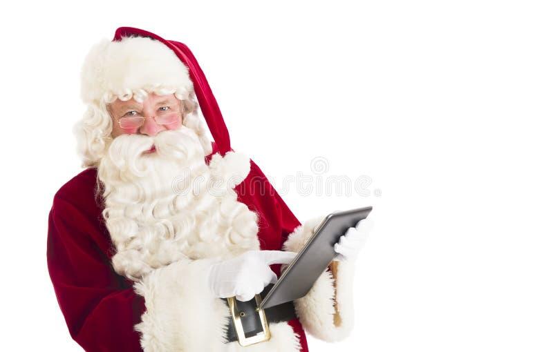 Ritratto di Santa Claus Using Digital Tablet immagini stock