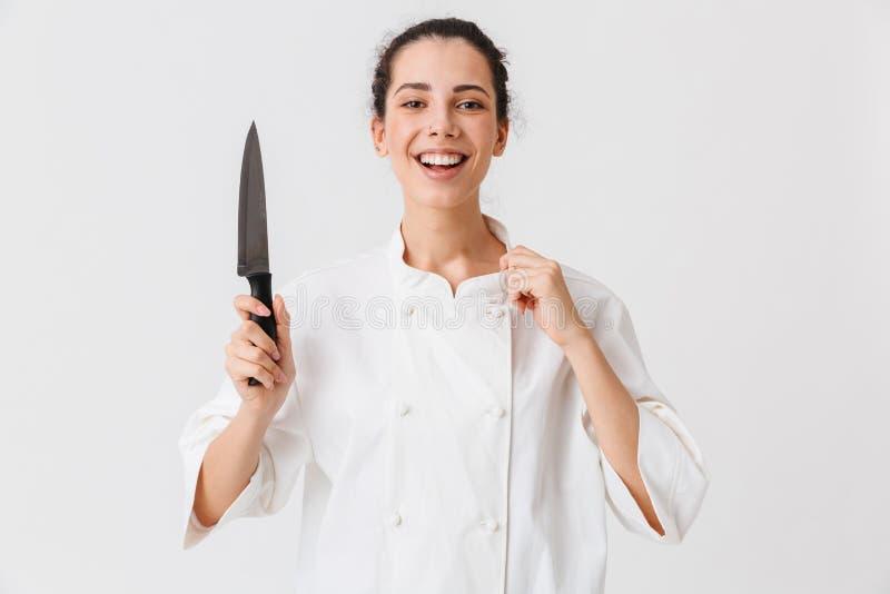 Ritratto di un cuoco sicuro della giovane donna fotografia stock libera da diritti