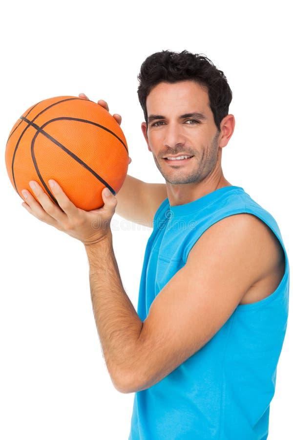 Ritratto di un giocatore di pallacanestro con la palla immagine stock libera da diritti