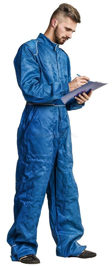 Ritratto di un lavoratore sul fondo della fabbrica fotografie stock