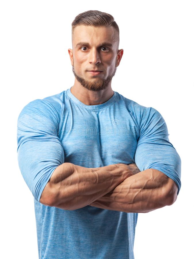 Ritratto di un modello maschio muscolare su fondo bianco fotografia stock
