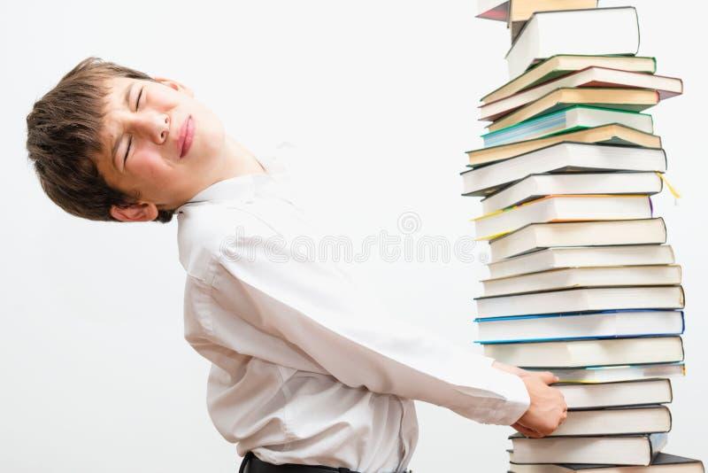 Ritratto di un ragazzo con i libri fotografia stock