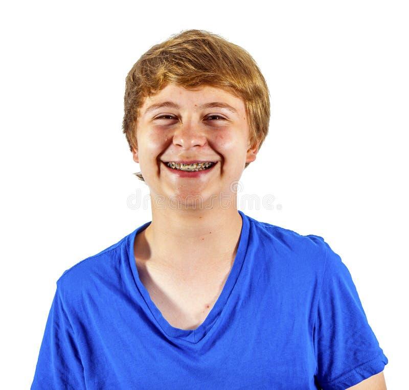 Ritratto di un ragazzo teenager con i ganci in studio fotografie stock