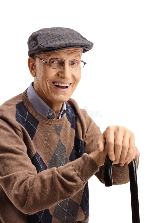 Ritratto di un uomo anziano felice con una canna fotografia stock libera da diritti