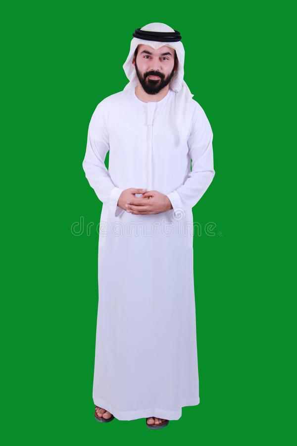 Ritratto di un uomo arabo sicuro che accoglie favorevolmente e che porta il vestito tradizionale UAE EMIRATI dei UAE SICURO immagini stock