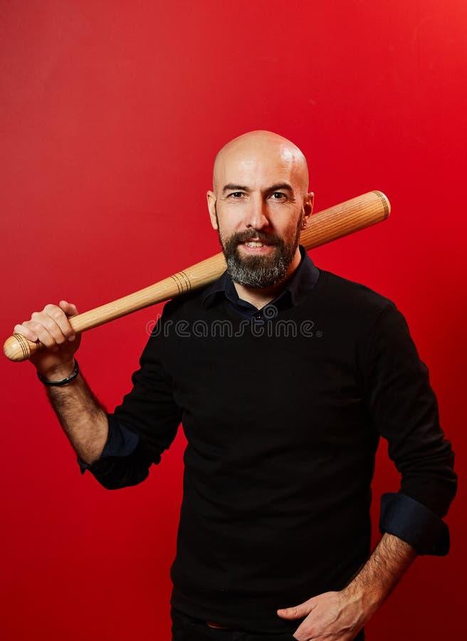 Ritratto di un uomo con il pipistrello immagini stock libere da diritti