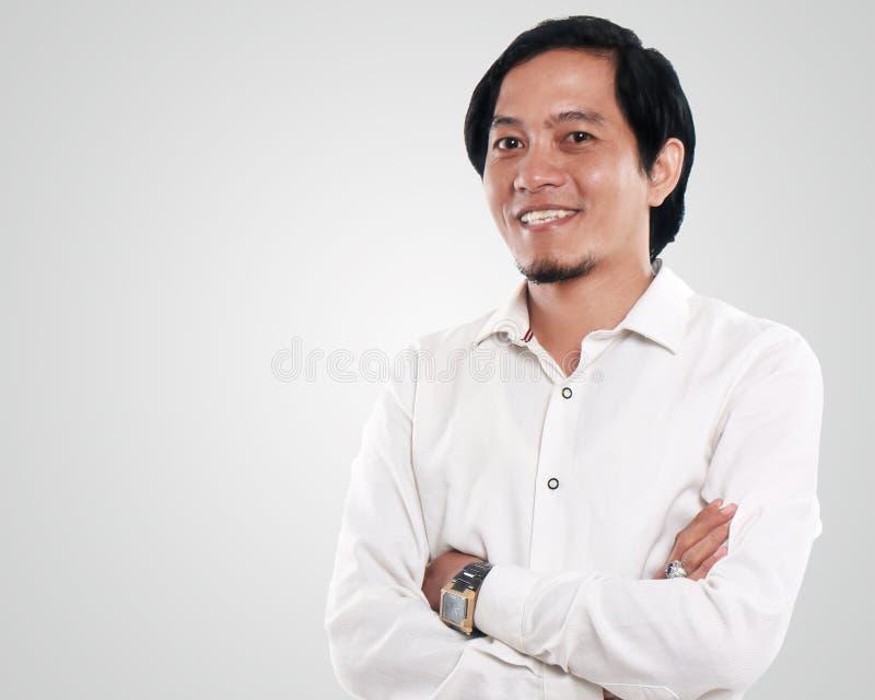 Ritratto di un uomo d'affari asiatico felice immagini stock libere da diritti