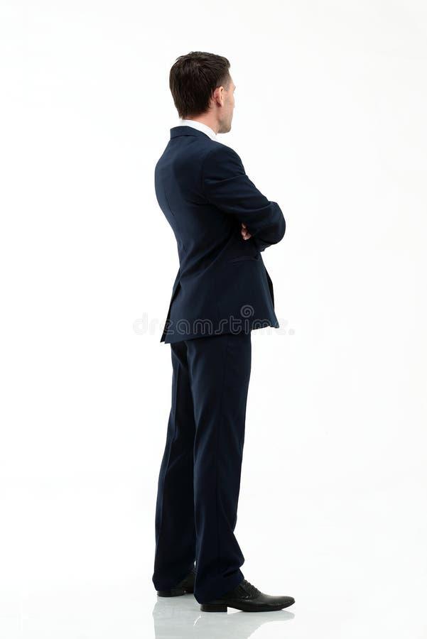Ritratto di un uomo d'affari bello che guarda con confidenza in avanti immagine stock