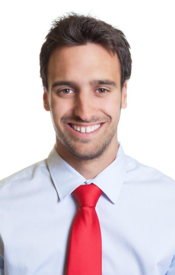 Ritratto di un uomo d'affari con il legame rosso immagine stock