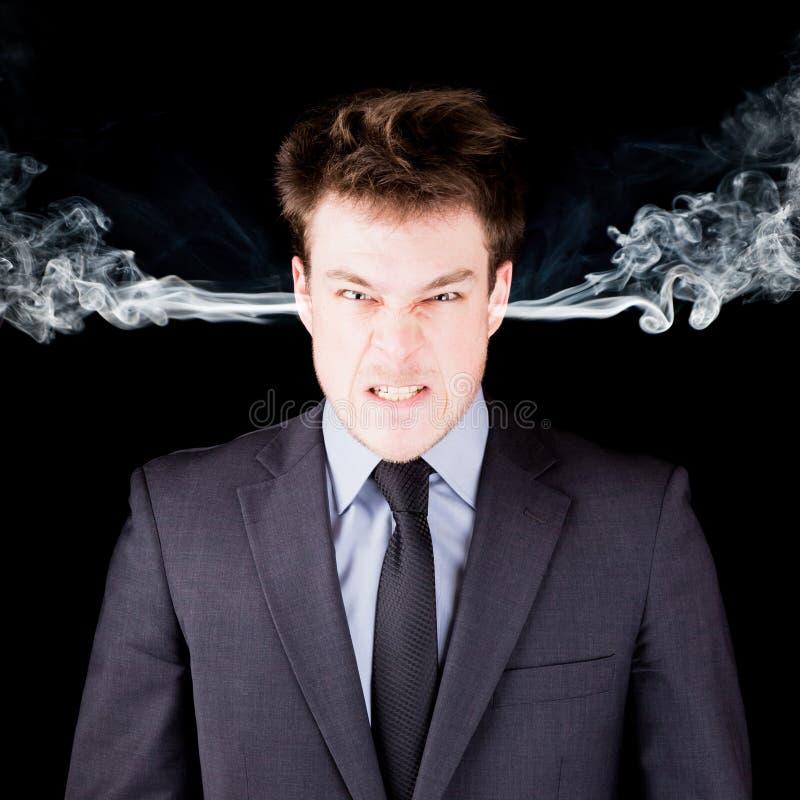 Ritratto di un uomo d'affari furioso fotografia stock
