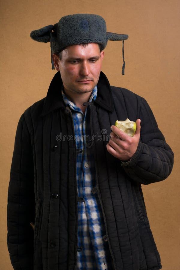 Ritratto di un uomo in un'uniforme per un'azienda agricola fotografie stock libere da diritti