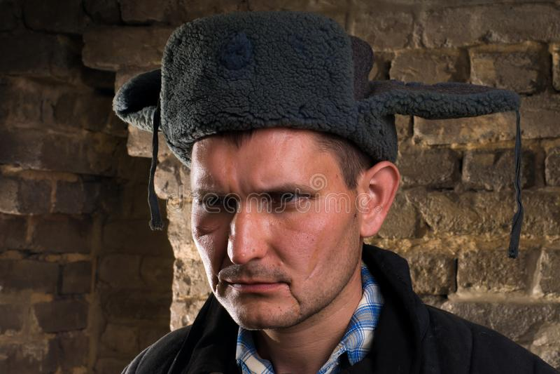 Ritratto di un uomo in un'uniforme per un'azienda agricola fotografia stock libera da diritti