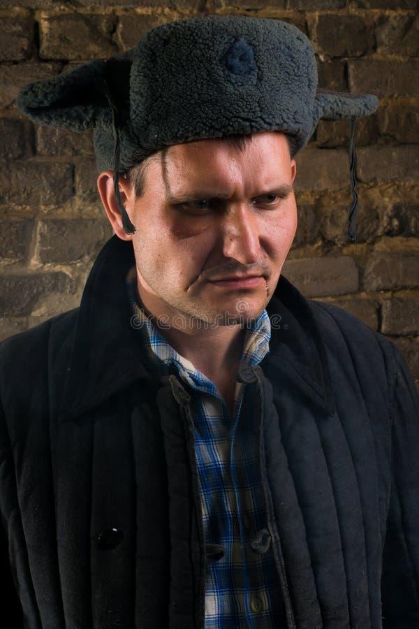 Ritratto di un uomo in un'uniforme per un'azienda agricola immagini stock libere da diritti