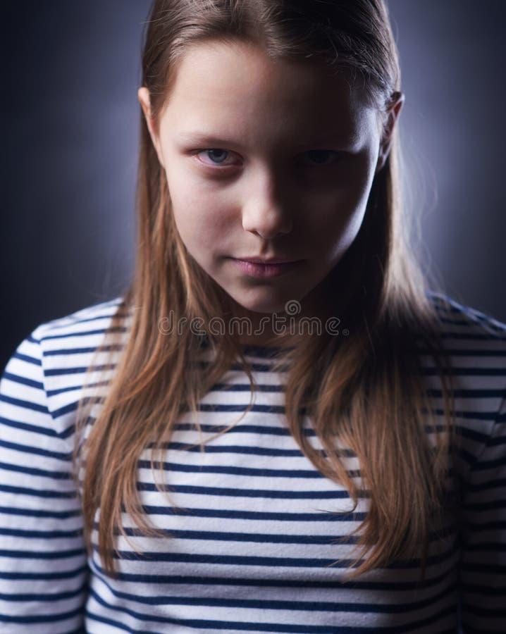 Ritratto di una bambina con il fronte diabolico immagini stock libere da diritti