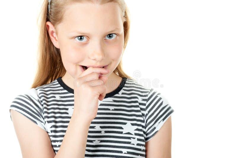 Ritratto di una bambina timida su bianco fotografia stock