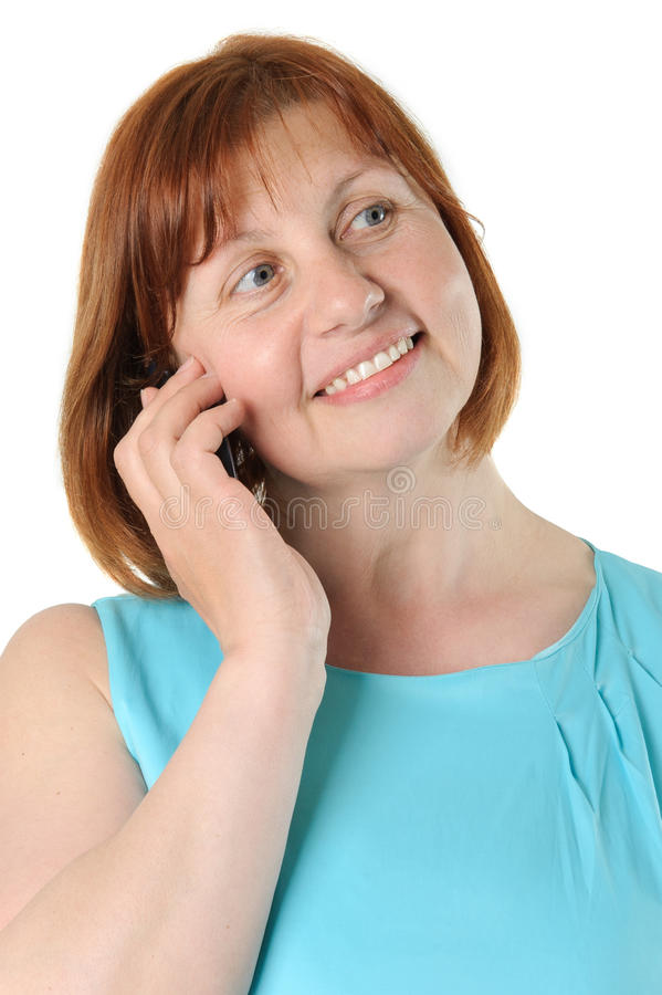 Ritratto di una donna di mezza età abbastanza dai capelli rossi che sta parlando fotografia stock