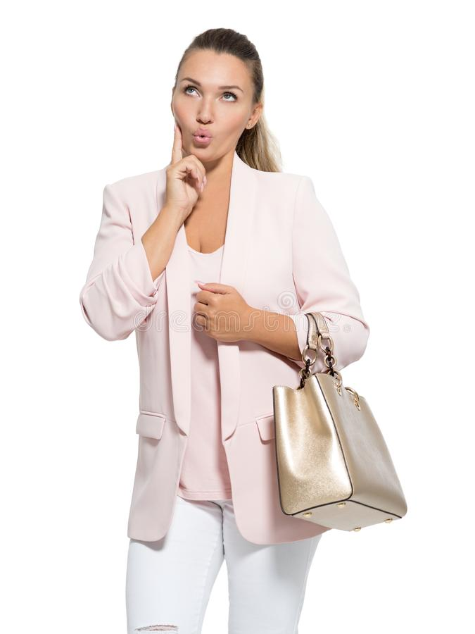 Ritratto di una donna felice domandantesi sopra fondo bianco immagini stock libere da diritti