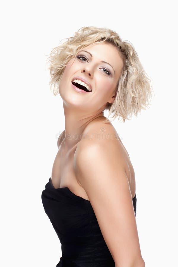 Ritratto di una giovane donna con capelli biondi fotografia stock libera da diritti