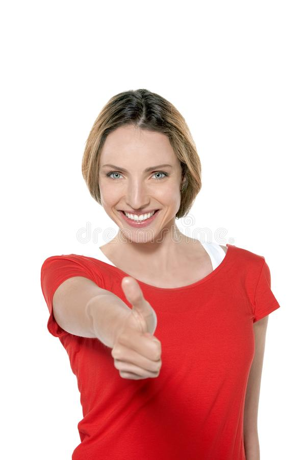 Ritratto di una giovane donna sorridente splendida con il pollice su fotografia stock libera da diritti