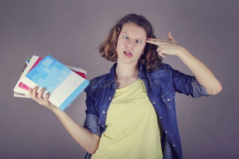 Ritratto di una ragazza con i libri, concetto di istruzione fotografie stock
