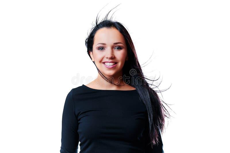 Ritratto di una ragazza di risata positiva con capelli scuri lunghi Isolat fotografia stock