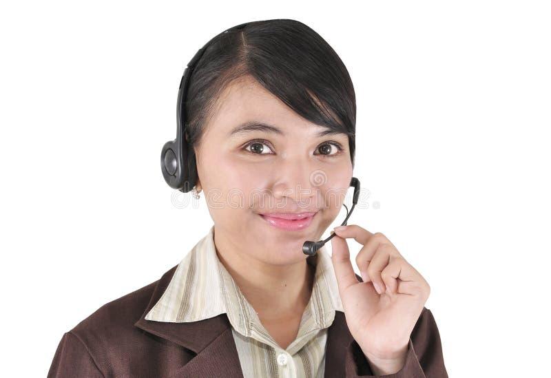 Ritratto di una ragazza sorridente di servizio di assistenza al cliente immagine stock libera da diritti