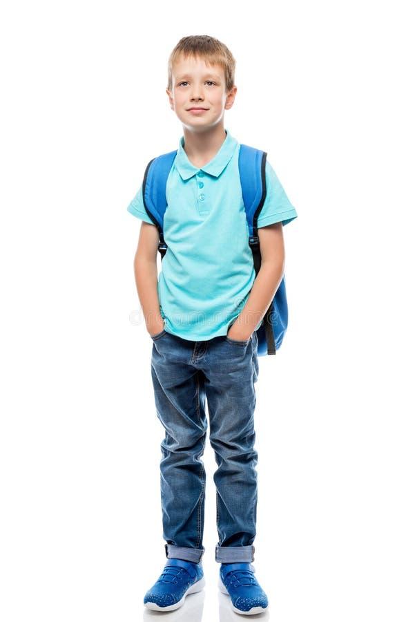Ritratto di uno scolaro in integrale su un bianco fotografia stock libera da diritti