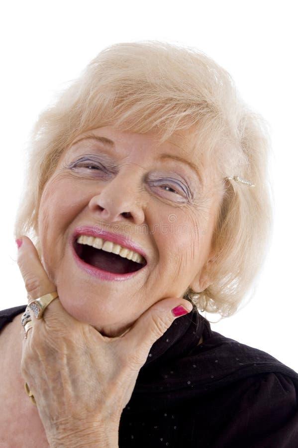 Ritratto di vecchia holding femminile il suo fronte fotografie stock